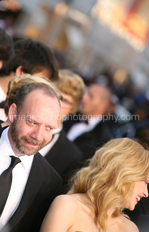 Actor Paul Giamatti and actress Sarah Gadon at the Cosmopolis gala screening at the 65th Cannes Film Festival France. Cosmopolis is directed by David Cronenberg and based on the book by writer Don Dellilo.  Friday 25th May 2012 in Cannes Film Festival, France.