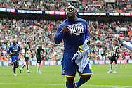 Bayo Akinfenwa forward for AFC Wimbledon (10) scores from the penalty spot and celebrates making it 2-0 during the Sky Bet League 2 play off final match between AFC Wimbledon and Plymouth Argyle at Wembley Stadium, London, England on 30 May 2016. Photo by Stuart Butcher.