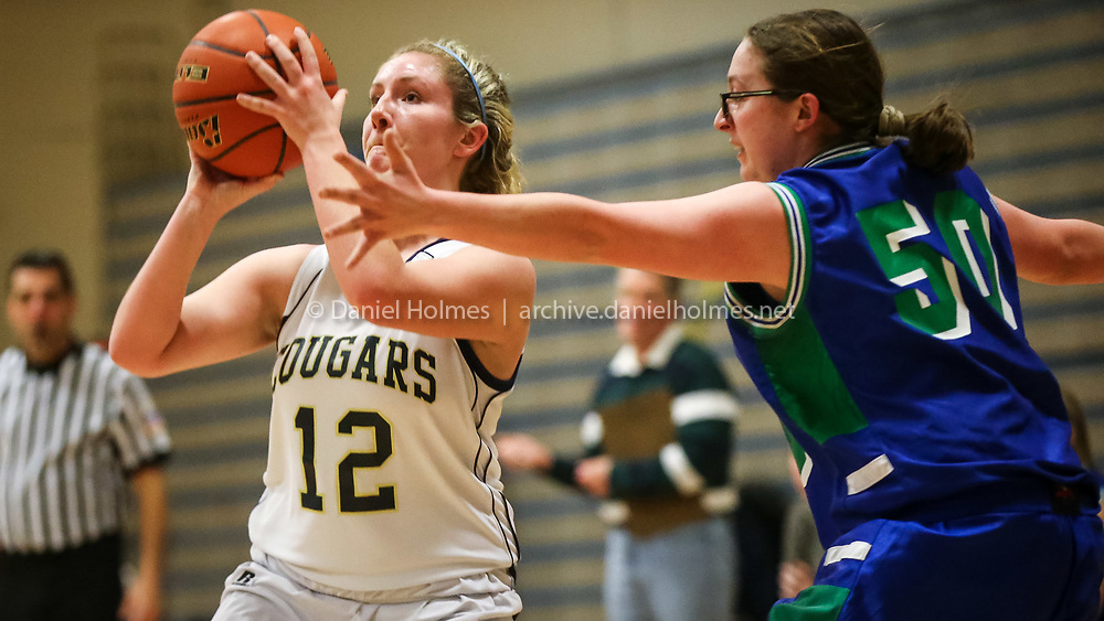 (2/12/15, FRANKLIN, MA) Tri-County's Morgan Gould shoots a three-pointer during the girls basketball game against Blue Hills at Tri-County High School in Franklin on Thursday. Daily News and Wicked Local Photo/Dan Holmes