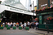Sign for Borough Market opposite the Market Porter pub in London, England, United Kingdom. Borough Market is a retail food market and farmers market in Southwark. It is one of the largest and oldest food markets in London, with a market on the site dating back to at least the 12th century. A farmers market is a physical retail marketplace intended to sell foods directly by farmers to consumers. Farmers markets may be indoors or outdoors and typically consist of booths, tables or stands where farmers sell fruits, vegetables, meats, cheeses, and sometimes prepared foods and beverages.