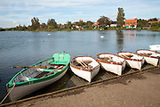 Rowing boats on the Meare, Thorpeness, Suffolk, England