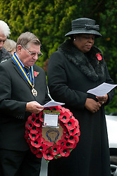 Waiting to lay a wreath at the War memorial in Chapeltown Park in Sheffield South Yorkshire up during the local Remembrance Day service 2011.13 November 2011. Image © Paul David Drabble