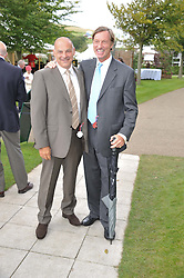 Left to right, HOWARD KRUGER and LORD BROCKETT at the 3rd day of the 2012 Glorious Goodwood racing festival at Goodwood Racecourse, West Sussex on 2nd August 2012.