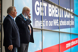 © Licensed to London News Pictures. 29/09/2019. Manchester, UK. Two delegates smoke cigars on first day of the Conservative Party Conference at Manchester Central in Manchester. Photo credit: Andrew McCaren/LNP