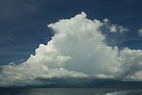 Huge rain clouds over Labilabi, Halmahera viewed from the bay.