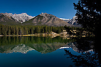 The Fairholme Range over Johnson Lake in Banff National Park.