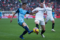 December 16, 2018 - Seville, Andalucia, Spain - Sergi Gomez  of Sevilla FC and Pere Pons of Girona CF competes for the ball during the LaLiga match between Sevilla FC and Girona at Estadio Ramón Sánchez Pizjuán on December 16, 2018 in Seville, Spain  (Credit Image: © Javier MontañO/Pacific Press via ZUMA Wire)