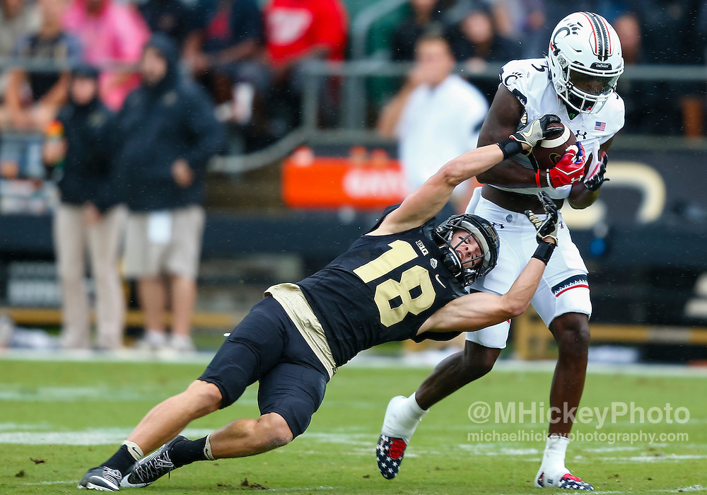 WEST LAFAYETTE, IN - SEPTEMBER 10: Cameron Posey #18 of the Purdue Boilermakers falls to the ground as Mike Tyson #5 of the Cincinnati Bearcats makes the interception at Ross-Ade Stadium on September 10, 2016 in West Lafayette, Indiana.  (Photo by Michael Hickey/Getty Images) *** Local Caption *** Cameron Posey; Mike Tyson