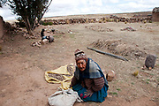 Bolivia 2013.Huayhuasi. Paula, Teodosia's 92 year old grandmother sorting potatoes.