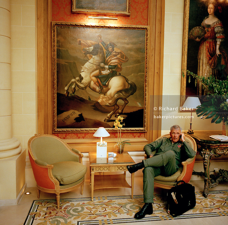 Pilot of the Red Arrows, Britain's RAF aerobatic team relaxes in hotel after their Bastille Day flypast over Paris.