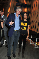 Left to right, the MARQUESS & MARCHIONESS OF WORCESTER at the Pig Business Fundraiser, Sake No Hana, St.James's, London on 26th September 2012.