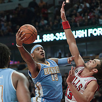 08 November 2010: Denver Nuggets' small forward #15 Carmelo Anthony goes to the basket against Chicago Bulls' center #13 Joakim Noah during the Chicago Bulls 94-92 victory over the Denver Nuggets at the United Center, in Chicago, Illinois, USA.