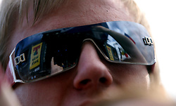Sunglass reflection of Arcade Fire on the main Stage, at T in the Park, Saturday 7 July 2007..T in the Park festival took place on the 6th, 7th and 8 July 2007, at Balado, near Kinross in Perth and Kinross, Scotland. This was the first time the festival had been held over three days..Pic ©Michael Schofield. All Rights Reserved..