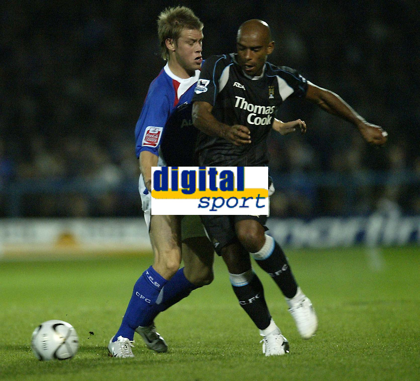 Photo: Aidan Ellis.<br /> Chesterfield United v Manchester City. Carling Cup. 20/09/2006.<br /> City's Trevor Sinclair nips the ball away from Chesterfield's Kevan Hurst