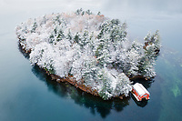 https://Duncan.co/small-island-with-red-boathouse-and-fresh-snow