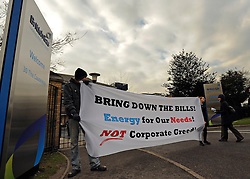 © Licensed to London News Pictures. 30/01/2012, Staines, UK. Protesters outside the building hold a banner. 6 activists have barricaded themselves into meeting rooms on two floors of British Gas offices in Staines, Middlesex, as part of the 'Winter Warm-Up' weekend called by the campaign group Fuel Poverty Action. British Gas is being targeted as one of the Big Six energy companies making profits out of rising energy bills.   Photo credit : Stephen Simpson/LNP