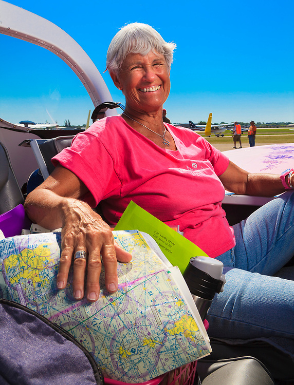 This pilot was just itching to get in the air, and did so immediately after being photographed.  She flies a homebuilt Van's Aircraft RV-12.  Created during AirVenture 2011 in Oshkosh, Wisconsin, for General Aviation News.
