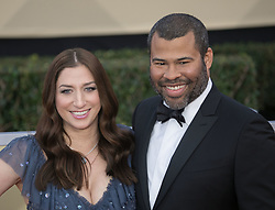 January 21, 2018 - Los Angeles, California, U.S - Actor Chelsea Peretti (L) and director Jordan Peele at the red carpet of the 24th Annual Screen Actors Guild Awards held at the Shrine Auditorium in Los Angeles, California, Sunday January 21, 2018. (Credit Image: © Prensa Internacional via ZUMA Wire)