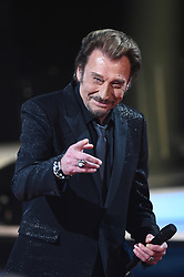 File photo : Johnny Hallyday attending the 28th Telethon, France's biggest annual fund-raising event with 30 hours of live television transmission, on December 6, 2014 in Paris, France. The event aims to collect funds for research on genetic diseases such as myopathy, a neuromuscular disease. France's biggest rock star Johnny Hallyday has died from lung cancer, his wife says. He was 74. The singer - real name Jean-Philippe Smet - sold about 100 million records and starred in a number of films. Photo by Nicolas Gouhier / ABACAPRESS.COM