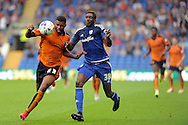 Wolves' Ethan Ebanks-Landell (l) is challenged by Cardiff City's Sammy Ameobi. Skybet football league championship match, Cardiff city v Wolverhampton Wanderers at the Cardiff city stadium in Cardiff, South Wales on Saturday 22nd August 2015.<br /> pic by Carl Robertson, Andrew Orchard sports photography.