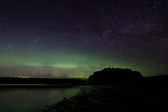 The aurora borealis in display above Bartlett Cove in Glacier Bay National Park and Preserve, Alaska.