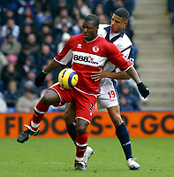 Photo: Dave Linney.<br />West Bromwich Albion v Middlesbrough. The Barclays Premiership. 26/02/2006West Brom's .Curtis Davies(R) keeps a close eye on  Aiyegbeni Yakuba