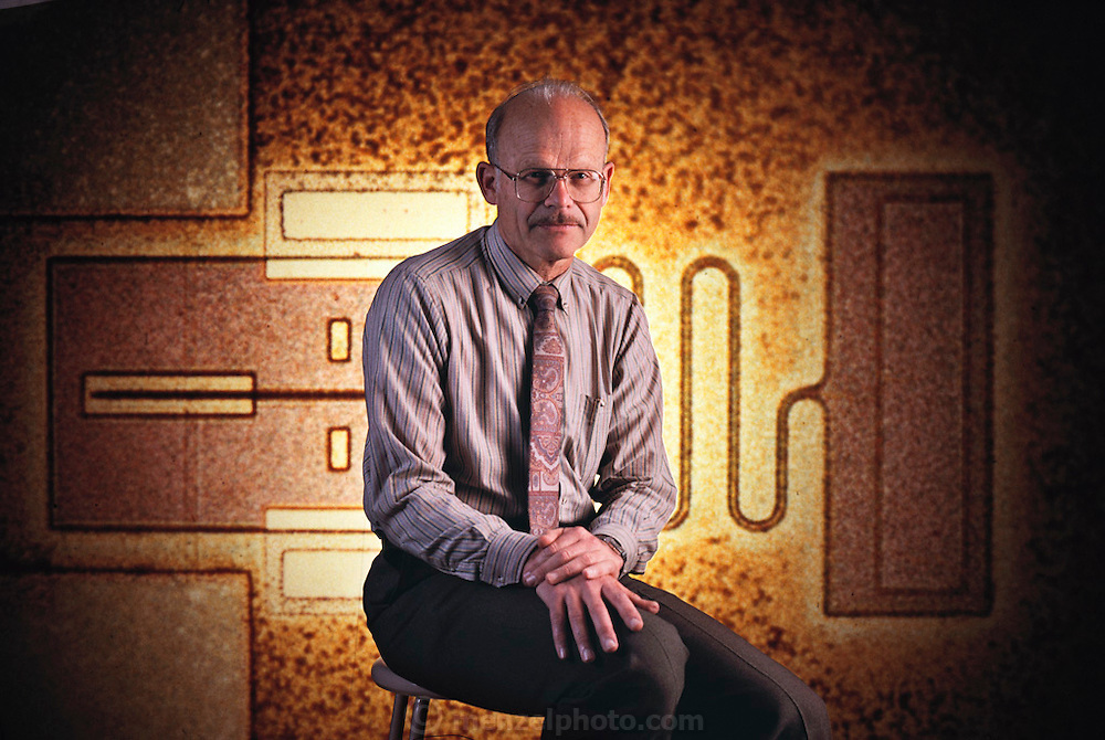 Professor Richard Muller, head of the micromechanic engineering department at U.C. Berkeley, with a blow-up of a 1-millimeter linear switching element. Model Released.[1990]