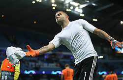 Lyon goalkeeper Anthony Lopes throws his shirt into the crowd after the final whistle