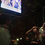 People react as Electoral College results are announced on U street in Washington DC before Barack Obama was announced the winner of the 2012 presidential elections.