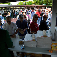 (PPAGE1) Monmouth Park 5/13/2006  A mad rush for programs after the gates were opened to the park.   Michael J. Treola Staff Photographer.....MJT
