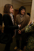Tracey Emin and Ronnie Wood. South Bank Show Awards, The Savoy Hotel. London. 27 January 2005. ONE TIME USE ONLY - DO NOT ARCHIVE  © Copyright Photograph by Dafydd Jones 66 Stockwell Park Rd. London SW9 0DA Tel 020 7733 0108 www.dafjones.com