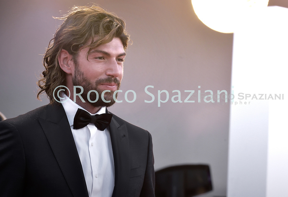 """VENICE, ITALY - SEPTEMBER 07:    Ignazio Moser walks the red carpet ahead of the movie """"Sniegu Juz Nigdy Nie Bedzie"""" (Never Gonna Snow Again) at the 77th Venice Film Festival on September 07, 2020 in Venice, Italy. <br /> (Photo by Rocco Spaziani)"""