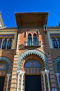 The arabesque architecture of the Museum of Arts and Traditions in America square, Seville Spain . The Royal Alcázars of Seville (al-Qasr al-Muriq ) or Alcázar of Seville, is a royal palace in Seville, Spain. It was built by Castilian Christians on the site of an Abbadid Muslim alcazar, or residential fortress.The fortress was destroyed after the Christian conquest of Seville The palace is a preeminent example of Mudéjar architecture in the Iberian Peninsula but features Gothic, Renaissance and Romanesque design elements from previous stages of construction. The upper storeys of the Alcázar are still occupied by the royal family when they are in Seville. <br /> <br /> Visit our SPAIN HISTORIC PLACES PHOTO COLLECTIONS for more photos to download or buy as wall art prints https://funkystock.photoshelter.com/gallery-collection/Pictures-Images-of-Spain-Spanish-Historical-Archaeology-Sites-Museum-Antiquities/C0000EUVhLC3Nbgw <br /> .<br /> Visit our MEDIEVAL PHOTO COLLECTIONS for more   photos  to download or buy as prints https://funkystock.photoshelter.com/gallery-collection/Medieval-Middle-Ages-Historic-Places-Arcaeological-Sites-Pictures-Images-of/C0000B5ZA54_WD0s