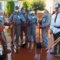 Far-right radical paramilitary organization Hungarian National Guard (Magar Nemzeti Gárda) members participate in recovery works in Devecser in Hungary's Veszprem county has been flooded by toxic sludge released by a dam accident in a nearby container. The toxic chemicals left its red marking on all the walls of the houses in and out and covered all moveable belongings and streets killing people and animals. Red sludge is a waste from bauxite fefining that has a strong caustic effect. The toxic flood covered an area of over 800-1,000 hectares (1,920-2,400 acres). Seven people were killed and more than 150 injured in the disaster. Pollution from the red sludge now spread into the local rivers killing all life in rivers Marcal and Torna and now it mixed into the main European waterway river Danube. Officials say there is no risk of a biological or enviromental catastrophe there.  Devecscer, Hungary, Saturday, 09. October 2010. ATTILA VOLGYI