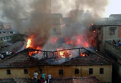 February 4, 2018 - Kolkata, West Bengal, India - A fire broke out in a slum opposite to Rajabazar science College at around 4.30 pm. (Credit Image: © Sandip Saha/Pacific Press via ZUMA Wire)