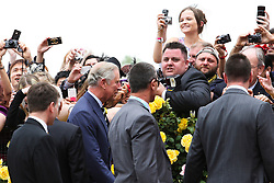 © Licensed to London News Pictures. 06/11/2012. Members of the crowd take photos of the Prince of Wales, Prince Charles as he walks past during the Emirates Melbourne Cup at the Flemington Racecourse, Melbourne. Photo credit : Asanka Brendon Ratnayake/LNP