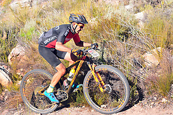 WELLINGTON SOUTH AFRICA - MARCH 22: Andrew Mclean during stage three's 111km from Wellington to Worcester on March 22, 2018 in Western Cape, South Africa. Mountain bikers gather from around the world to compete in the 2018 ABSA Cape Epic, racing 8 days and 658km across the Western Cape with an accumulated 13 530m of climbing ascent, often referred to as the 'untamed race' the Cape Epic is said to be the toughest mountain bike event in the world. (Photo by Dino Lloyd)