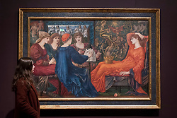 """© Licensed to London News Pictures. 22/10/2018. LONDON, UK. A staff member views """"Laus Veneris"""", 1873-8, by Edward Burne-Jones.  Preview of the largest Edward Burne-Jones retrospective to be held in a generation at Tate Britain.  Burne-Jones was a pioneer of the symbolist movement and the only Pre-Raphaelite to achieve world-wide recognition in his lifetime.  The exhibition runs 24 October to 24 February 2019.  Photo credit: Stephen Chung/LNP"""