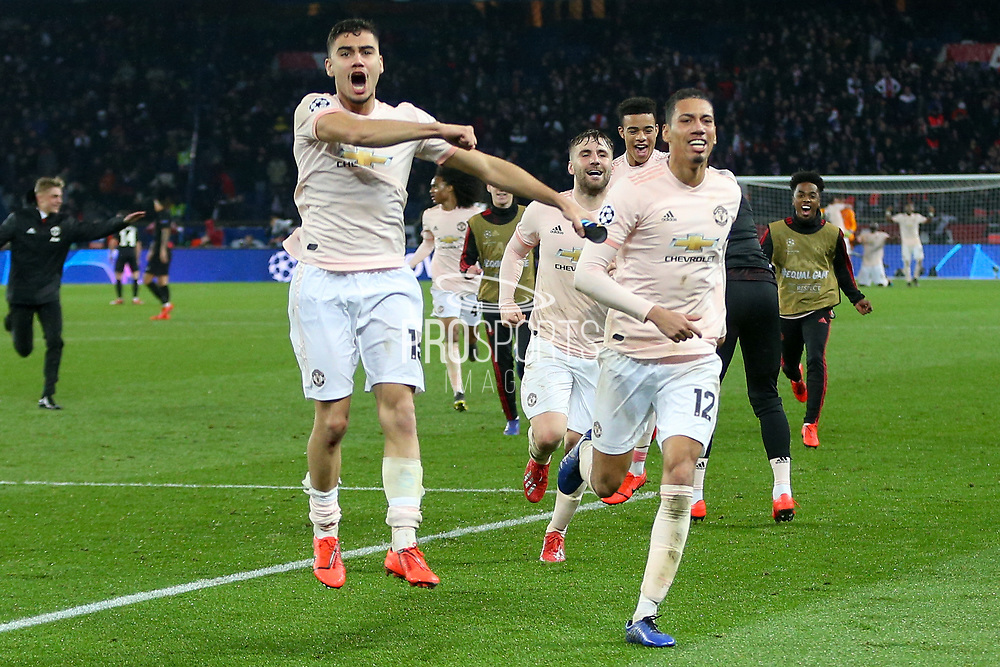 Manchester United Midfielder Andreas Pereira and Manchester United Defender Chris Smalling celebrate after the final whistle with Manchester United Defender Luke Shaw during the Champions League Round of 16 2nd leg match between Paris Saint-Germain and Manchester United at Parc des Princes, Paris, France on 6 March 2019.