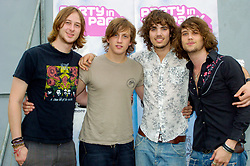 Rooster an English hard rock band from London play Party In The Park Temple Newsome Leeds 17th July 2005<br /> Formed in 2003, the group featured vocalist Nick Atkinson, guitarist Luke Potashnick, bassist Ben Smyth and drummer Dave Neale