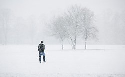 © Licensed to London News Pictures. 14/01/2013. London, United Kingdom ..A man struggles through the snow across Victoria Park in Leicester...Photo credit : Chris Winter/LNP