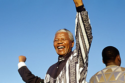 NELSON ROLIHLAHLA MANDELA (July 18, 1918 - December 5, 2013), 95, world renown civil rights activist and world leader. Mandela emerged from prison to become the first black President of South Africa in 1994. As a symbol of peacemaking, he won the 1993 Nobel Peace Prize. Joined his countries anti-apartheid movement in his 20s and then the ANC (African National Congress) in 1942. For next 20 years, he directed a campaign of peaceful, non-violent defiance against the South African government and its racist policies and for his efforts was incarcerated for 27 years. Remained strong and faithful to his cause, thru out his life, of a world of peace. Transforming the world, to make it a better place. PICTURED: 1994 - NELSON MANDELA, on the campaign trail South Africa. (Credit Image: © Greg Marinovich/ZUMA Wire/ZUMAPRESS.com)