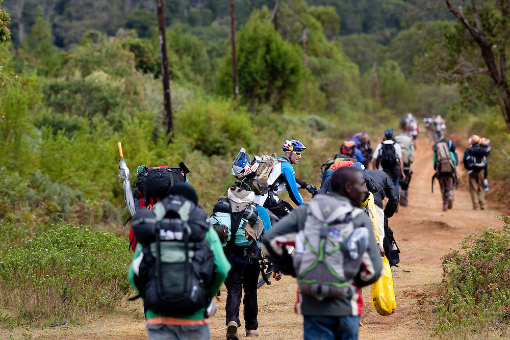 Location: Mont Kenya (Kenya) Urge Kenya 09/ The ultimate Mountain Bike gravity adventure at Mont-Kenya Athlete: Rene Wildhaber with the porters on his way to camp one Old Moses (altitude 3300 meters)
