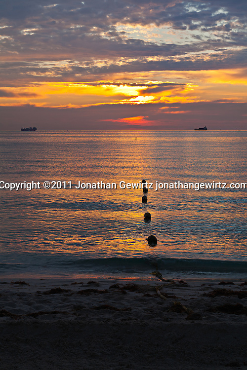 Miami Beach at sunrise with a floating swimming-area boundary and cargo ships on the horizon. WATERMARKS WILL NOT APPEAR ON PRINTS OR LICENSED IMAGES.