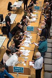 © Licensed to London News Pictures . 03/12/2015 . Oldham , UK . The first of the arriving ballots are counted . The count at the Oldham West and Royton by-election , at the Queen Elizabeth Hall in Oldham . The by-election was called following the death of MP Michael Meacher . Photo credit: Joel Goodman/LNP