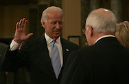 Vice President Elect Joe Biden takes the oath of office from Vice President Dick  Cheney at a mock swearing in photo session of U.S. Senators in the Old Senate Chambers of the U.S. Capitol in Washington, DC on January , 2009.  Vice President Elect Biden was sworn in as a Senator for the Senate election that he won in Delaware.  He will resign he Senate seat before the Inauguration. Photograph: Dennis Brack