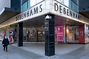 A shopper walks past the closed Debenhams department store in London's Oxford Street as the second lockdown of the Coronavirus pandemic comes to a end, and a day before London enters the Tier 2 restriction when retailers will be allowed to once again re-open for the run-up to Christmas, on 1st December 2020, in London, England. 12,000 jobs are said to be at risk after financial negotiations failed the day after Topshop owner Arcadia fell into administration.