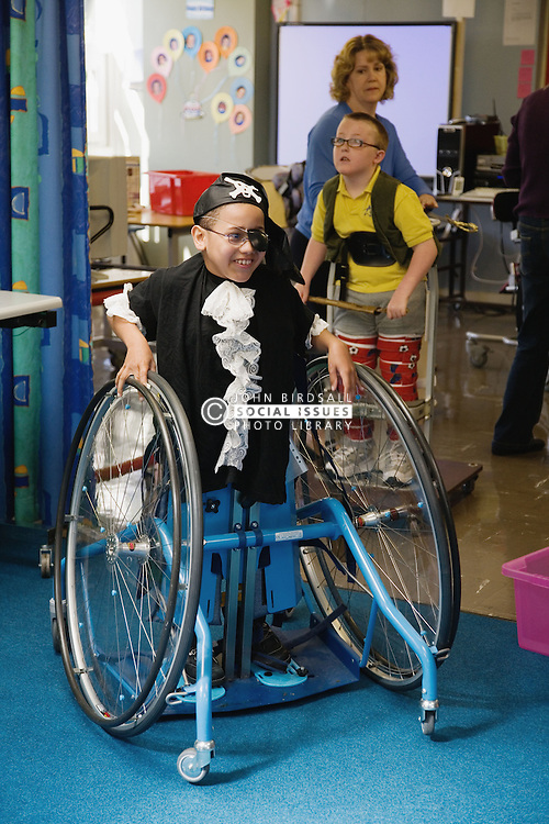 Child with Cerebral Palsy having fun dressed up as a pirate,