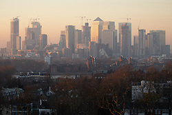 © Licensed to London News Pictures. 26/02/2019. London, UK. Smog is seen over the skyline of London at sunset last night, following days of unseasonably warm weather in the capital. Temperatures on Tuesday 26 February reached 20.8C in Porthmadog, north-west Wales, which was the warmest winter day on record. Sadiq Khan, the Mayor of London, has announced a high alert for air pollution in the capital. Photo credit : Tom Nicholson/LNP