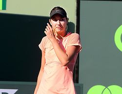 March 22, 2018 - Key Biscayne, FL, USA - Oceane Dodin of France during her match against Simona Halep of Romania in the first round of the Miami Open in Key Biscayne, Fla., on Thursday, March 22, 2018. Halep advanced, 3-6, 6-3, 7-5. (Credit Image: © Pedro Portal/TNS via ZUMA Wire)